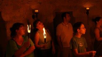 Visite aux flambeaux de la cité médiévale