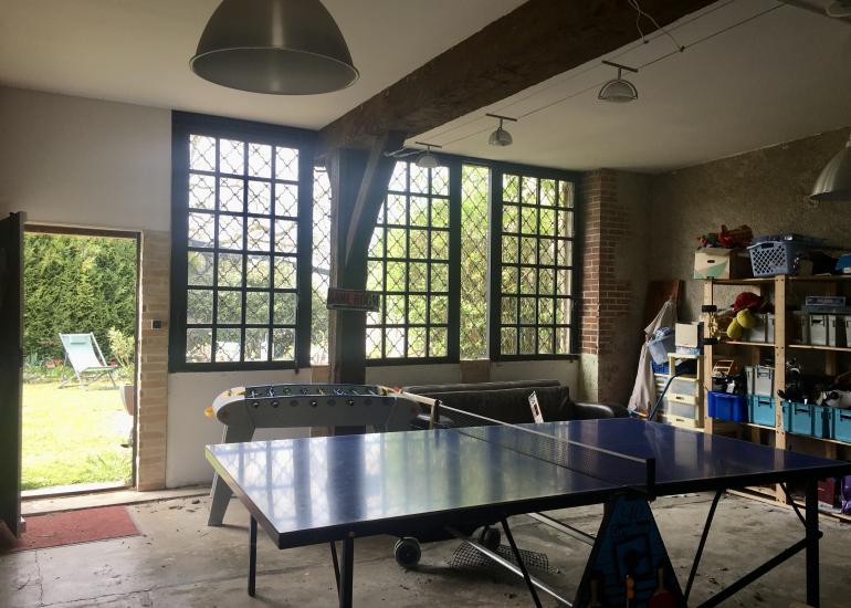 salle de jeux et accés sur le jardin privatif
